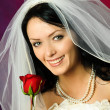 Young bride with a rose — Foto de Stock