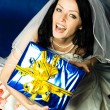 Young bride with a present — Stock Photo