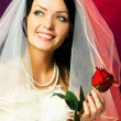 Beautiful bride with a rose — Stock Photo
