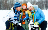 Family going ice skating — Stock Photo