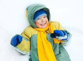 Happy child on the snow — Stock Photo