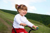 Girl riding a bysicle — Stock Photo