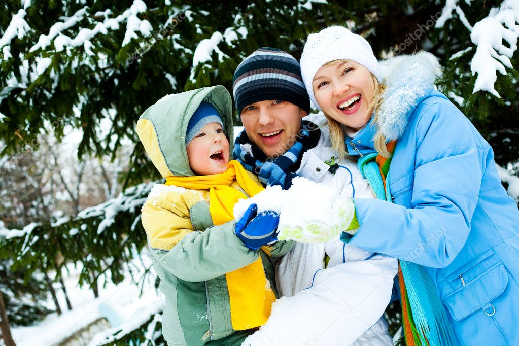 Happy young mother, father and their little son spending time outdoor in winter park  Stock Photo #1891051