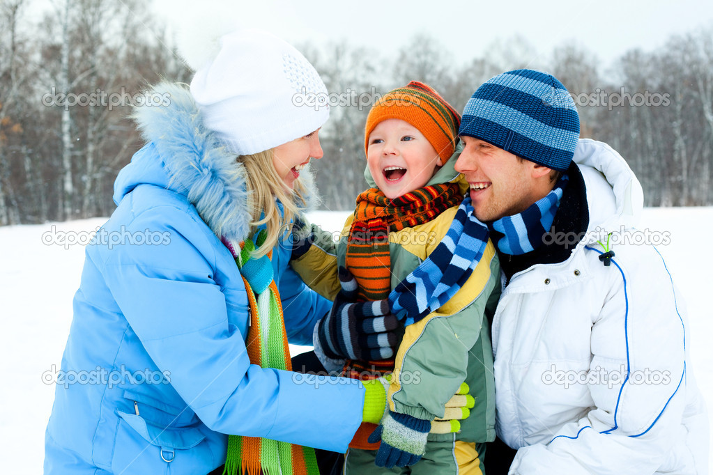 Happy young family spending time outdoor in winter  Stock Photo #1891455