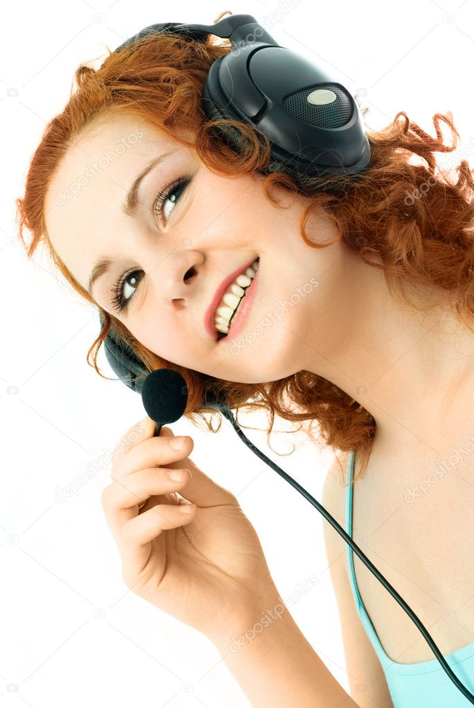 Beautiful young woman with curly ginger hair wearing earphones — Stock Photo #1892704