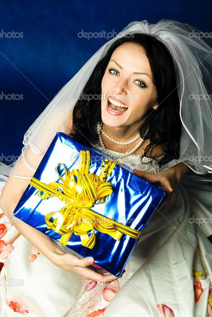 Studio portrait of a happy excited bride with a big present — Stock Photo #1893946