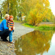 Stock Photo: mother and son near the lake