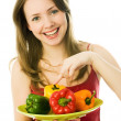 Happy woman with peppers — Stock Photo