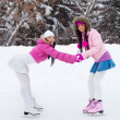 Two girls ice skating — Stock Photo #1903640