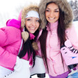 Two girls go ice skating — Stockfoto