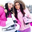 Two girls go ice skating - Stock Photo