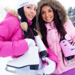 Two girls go ice skating — Stock Photo