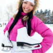 Girl going to ice skate — Stock Photo