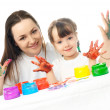 Mother and daughter painting with finger paints — Stock Photo