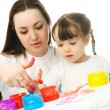 Mother and daughter painting with finger paints — Stock Photo #1904500