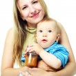 Mother feeding a baby — Stock Photo