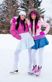 Two girls ice skating — Stock Photo