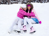 Girls going to ice skate — Stock Photo
