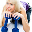 Stock Photo: Beautiful young woman with dumbbells