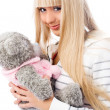 Pretty blond girl with a teddy bear — Stock Photo