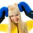 Happy girl wearing boxing gloves — Stock Photo