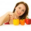 Beautiful woman with peppers — Stock Photo