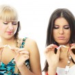 Two beautiful girls break cigarettes — Stock Photo