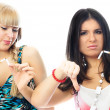 Stock Photo: Two beautiful girls breaking cigaretts