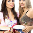 Two beautiful young students with books — Stock Photo