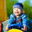 Happy boy driving a toy car — Stock Photo