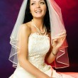 Beautiful happy laughing bride — Stock Photo