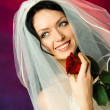 Stock Photo: Beautiful brunette bride with a red rose
