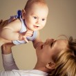 Happy mother with her baby — Stock Photo #1917932