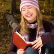 Laughing girl with a book — Foto de Stock