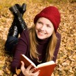Stock Photo: Beautiful girl reading a book