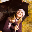 Happy girl with an umbrella — Stockfoto