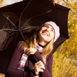 Happy girl with an umbrella — Stock fotografie