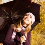 Happy girl with an umbrella — Stock Photo