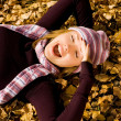 Happy girl on the grass in the park — Stock Photo
