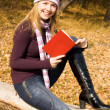 Royalty-Free Stock Photo: Pretty girl reading a book in the park
