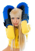 Scared woman wearing boxing gloves — Stock Photo