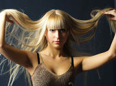 Young woman with luxurious long blond hair — Stock Photo