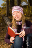Laughing girl with a book — Stock Photo