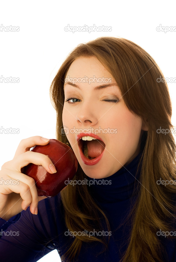 Beautiful young woman eats and apple and winks to us — Stock Photo #1916322