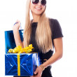 Stylish woman with presents - Stock Photo