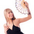 Beautiful dancer with a fan — Stock Photo