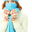 Young ginger woman wearing warm winter clothes - Stok fotoğraf