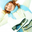 Stock Photo: Cheerful girl goes ice-skating
