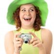 Excited young woman with a camera — Stock Photo