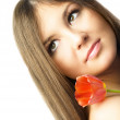 Beautiful woman with a tulip — Stock Photo